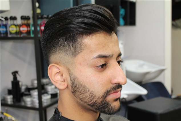 Low zero with two tone fade and  beard shape up.